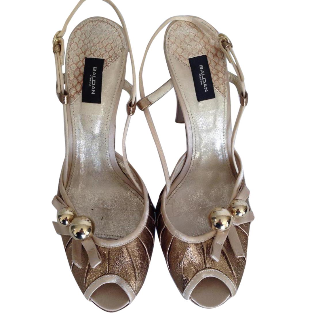 Baldan gold color sandals with wooden heels