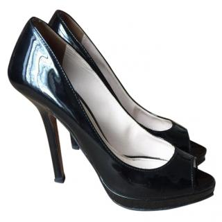Prada open toe pumps in black patent leather