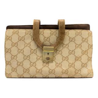 Gucci Beige Monogrammed Wallet