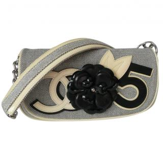 Chanel canvas camellia clutch