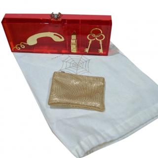 Charlotte Olympia pink and gold perspex clutch