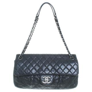 Chanel black quilted cross body flap bag