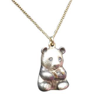 Anne Christine Bracey solid gold panda necklace.