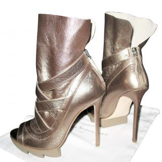 Camilla Skovgaard Metallic boots with zigzag platform