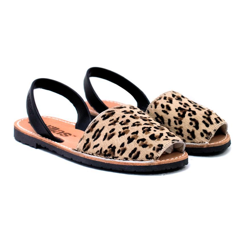 6b98fa6301d0 Solillas Leopard Print Pony Hair Sandals