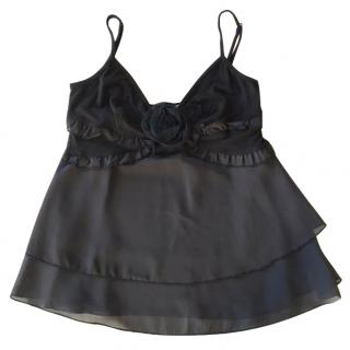 Red Valentino black silk top with ruffles and flower brooch