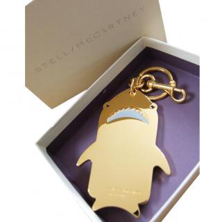 Stella McCartney gold shark keychain