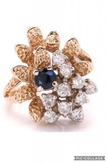 Gold cocktail ring with diamonds and sapphire