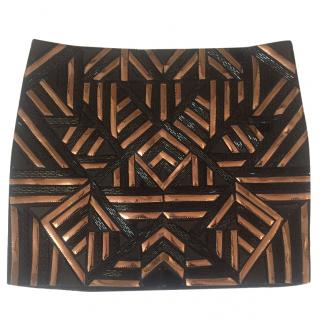 Amanda Wakeley black and rose gold mini skirt.