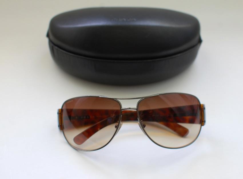 02afe8fba9e5 Prada Sunglasses. 21. 123456789. 1 ∕ 9