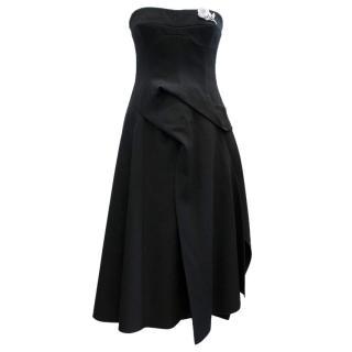 Victoria Beckham black strapless wool dress, white brooch
