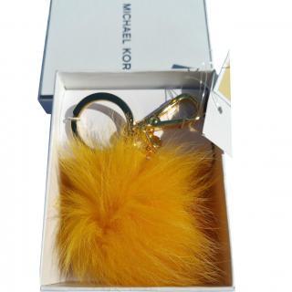 Michael Kors key charm fox fur small pom pom sunflower gold-tone chain