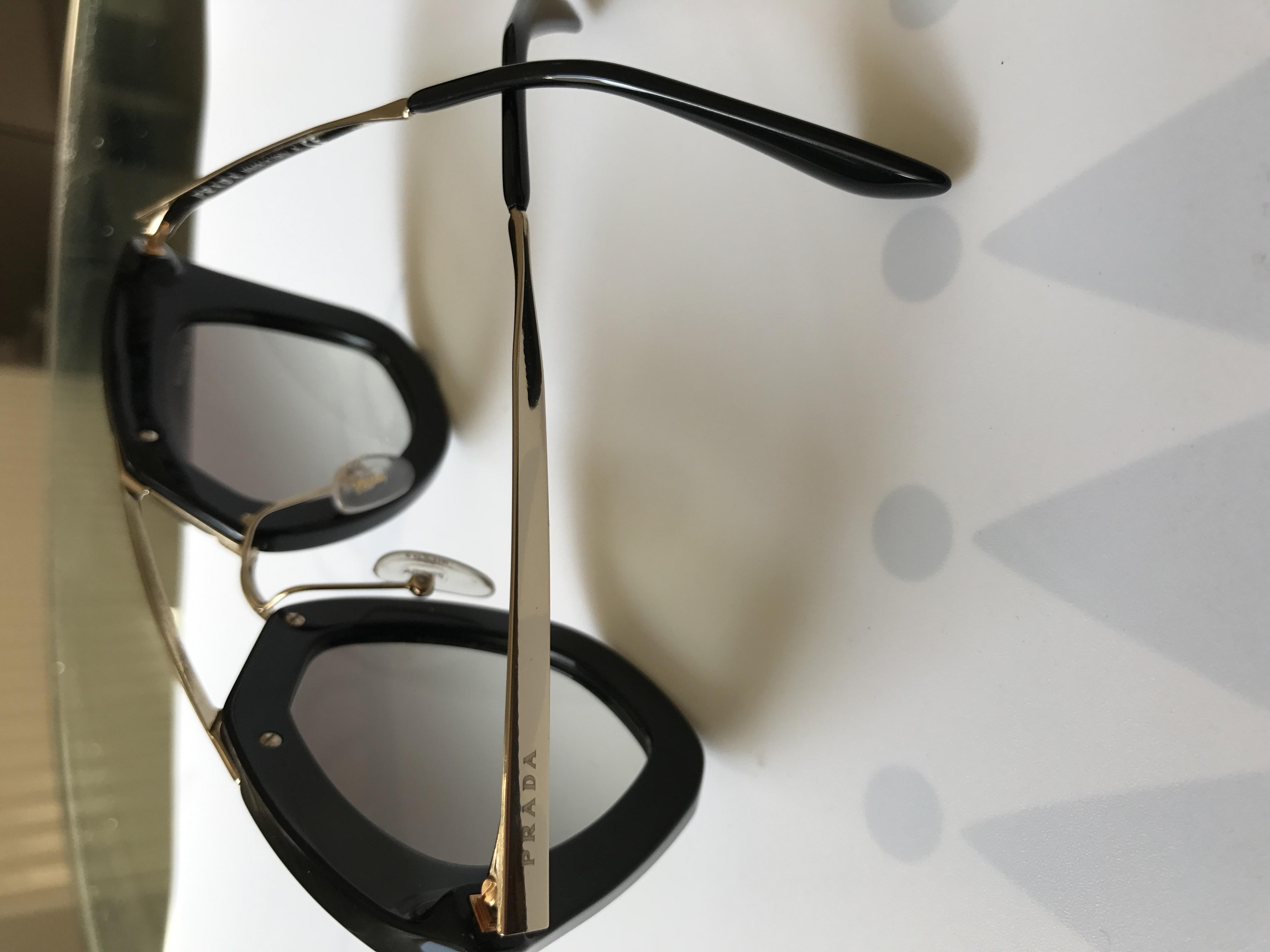66186647756e Prada sunglasses. 25. 123456789. 1 ∕ 9