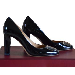 Bally Black patent pumps