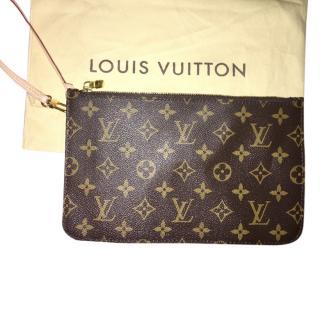 Louis Vuitton wrist pochette monogram.