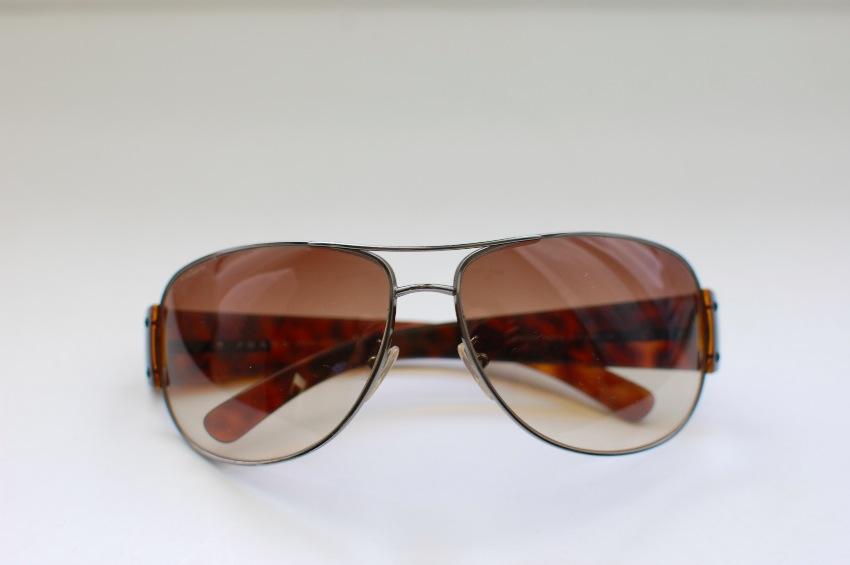 8873c864029a Prada Sunglasses. 26. 123456789. 1 ∕ 9
