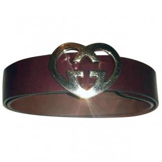 Gucci belt with gold heart buckle dark red color belt.