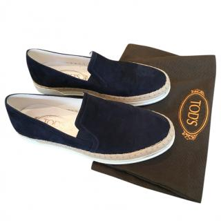 Tom's blue suede loafers