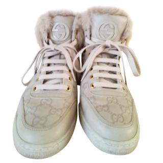 GUCCI leather/fur high top sneakers