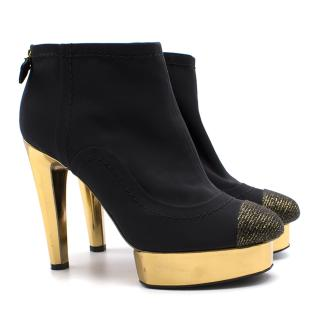 Chanel Black and Gold Heeled Boots