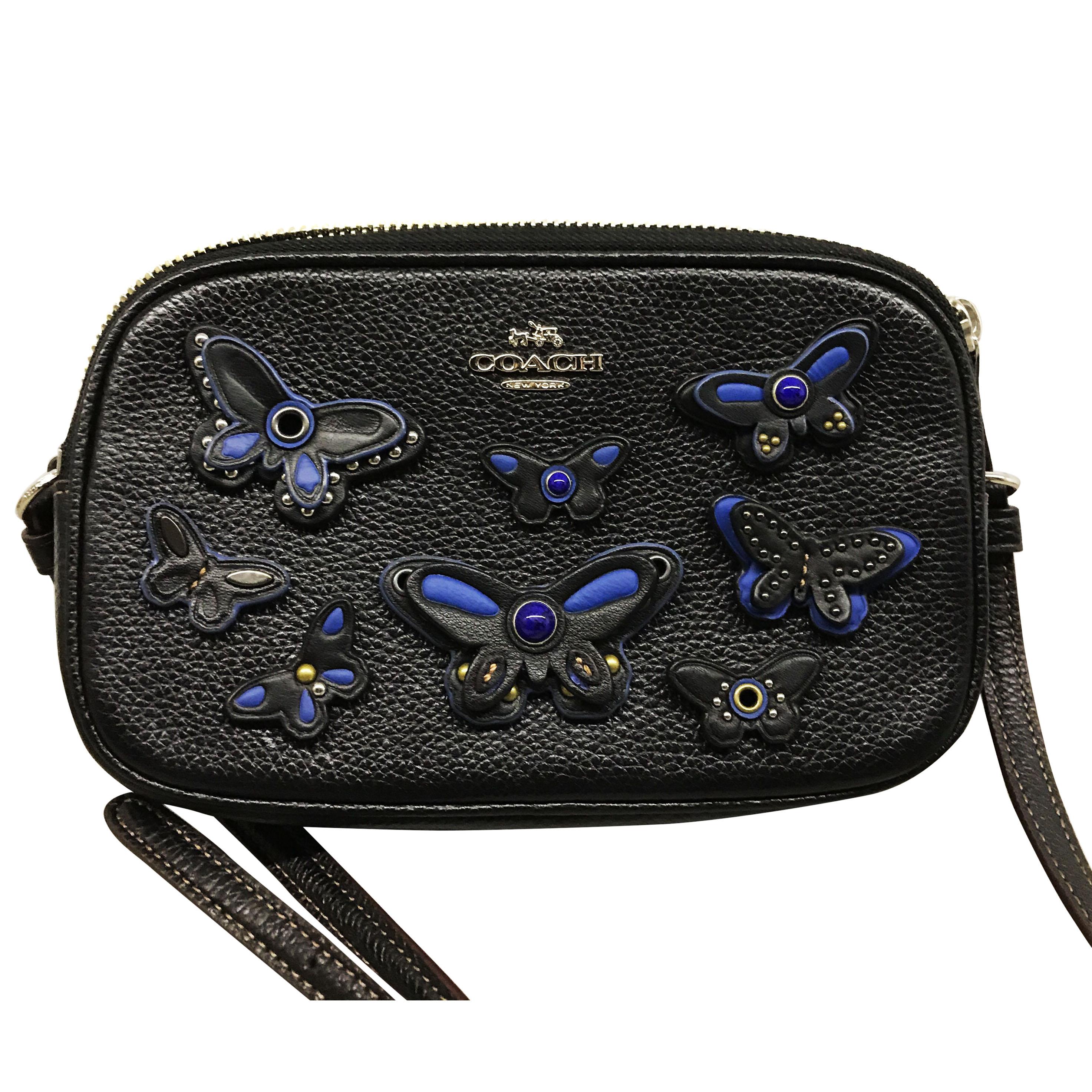 Coach black cross body bag with blue butterflies