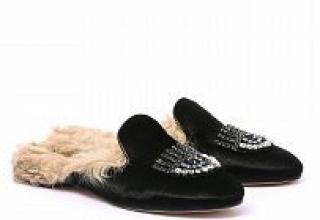 Chiara Ferragni black velvet jewels eyes fur interior mules