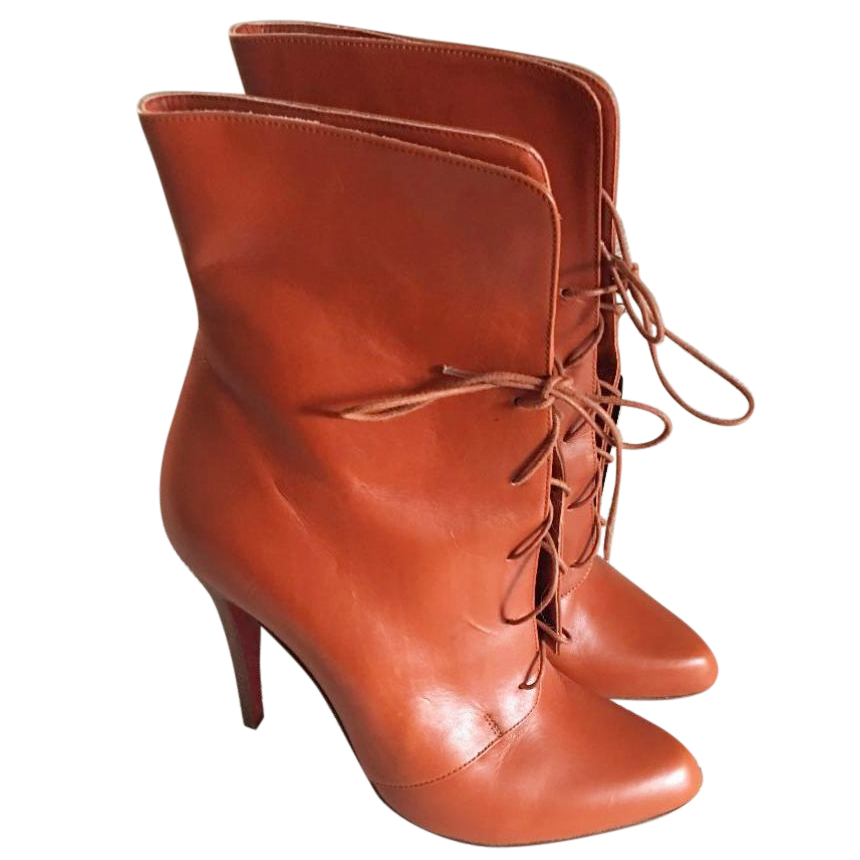 best service daa74 ba193 Christian Louboutin burnt orange lace up boots