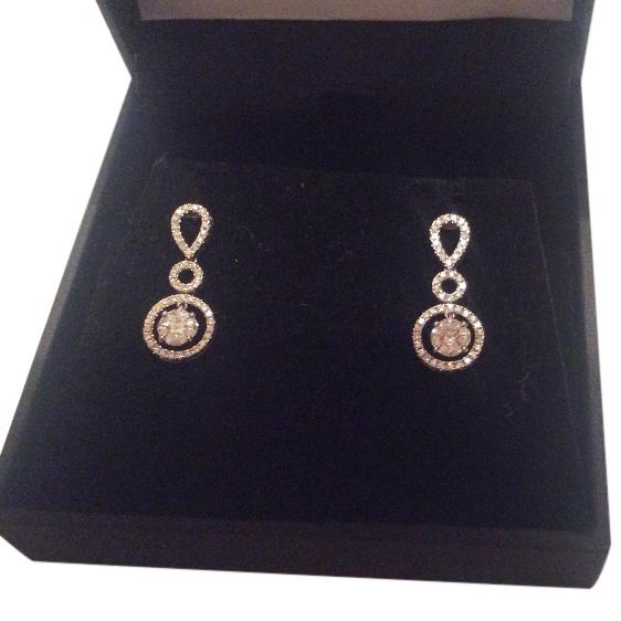 Bespoke diamond and 18 carat gold earings
