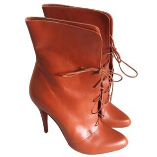 Christian Louboutin burnt orange lace up boots