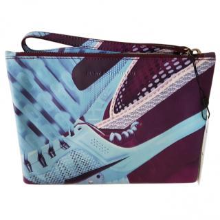 Purple leather clutch bag by Mary Katrantzou