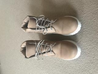 Timberland nude boots with white sole.