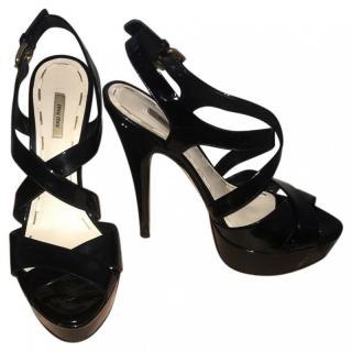 Miu Miu black patent high heels