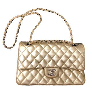 Chanel Gold quilted medium classic flap 2.55 bag