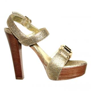 Alexander McQueen golden reptile print sandals