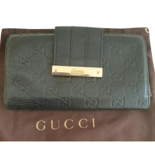 Gucci GG Monogram Leather Wallet