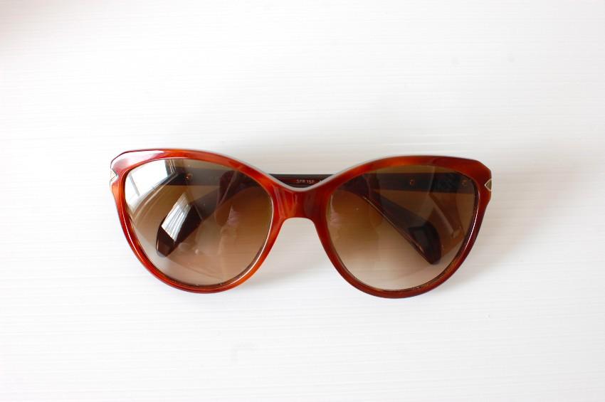c265dc139888 Prada Sunglasses. 28. 123456789. 1 ∕ 9