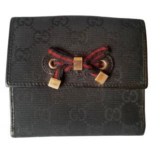 Gucci monogram black bow wallet