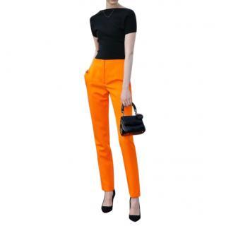Christian Dior bright orange tailored trousers