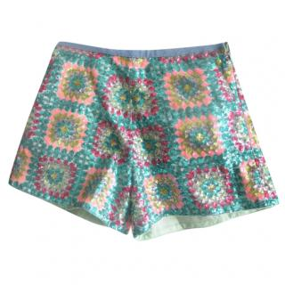 Manoush green sequin mini shorts