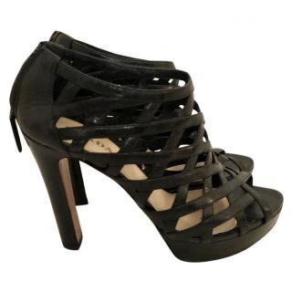 a24fe8e03b85 Prada Black Caged Sandals