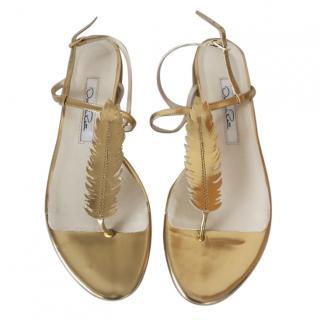 Oscar de la Renta gold flat feather sandals