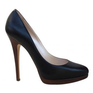 Casadei black leather pumps