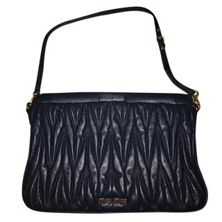 Miu Miu matelasse leather clutch with strap