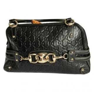 Gucci black GG embossed bag