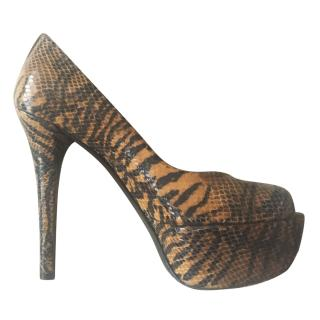 Stuart Weitzman animal print platform peep toe pumps