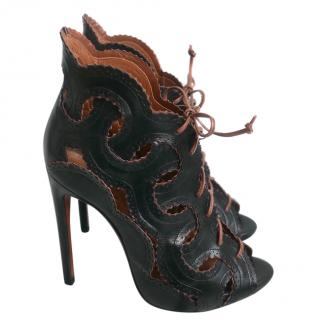 Alaia Black  interlocking-leather lace-up bootie heels