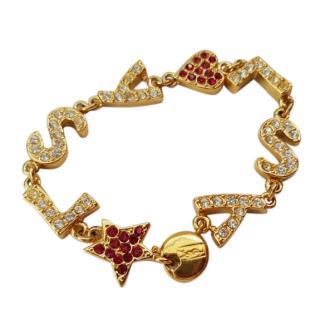 Yves Saint Laurent Vintage Gold Tone YSL Motive Bracelet