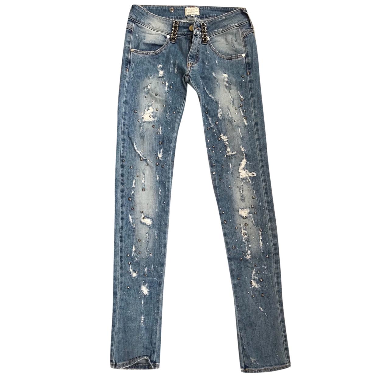 Met distressed skinny jeans