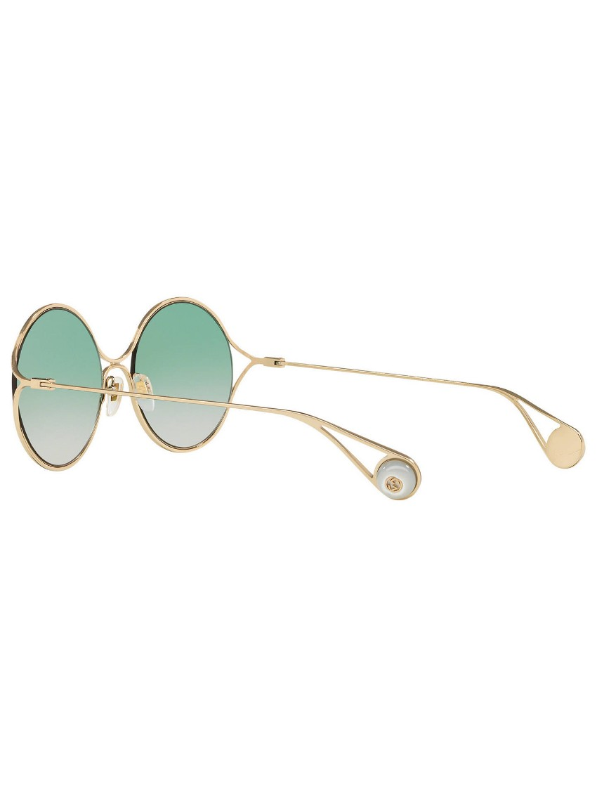 5b211a9732 Gucci pearlescent green lens round sunglasses. 26. 12345678910