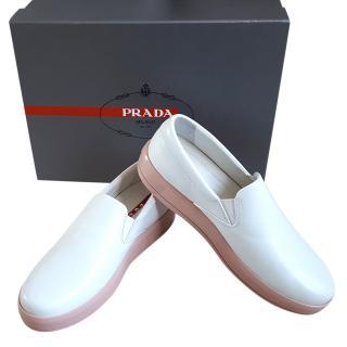 Prada white slip on sneakers